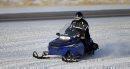 A snowmobiler ...