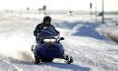 A snowmobilers departs from the 59er on Highway 59, Saturday, December 29, 2012. (TREVOR HAGAN/WINNIPEG FREE PRESS)