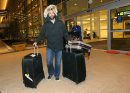 Toronto Blue Jays', Jose Bautista, pulls his luggage out of James Armstrong Richardson Airport, January 5, 2013. Winnipeg is one of the stops on the 3rd Annual Toronto Blue Jays Winter Tour. (TREVOR HAGAN/WINNIPEG FREE PRESS)