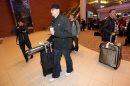 Toronto Blue Jays', Brett Cecil, followed by Aaron Loup, at James Armstrong Richardson Airport, January 5, 2013. (TREVOR HAGAN/WINNIPEG FREE PRESS)