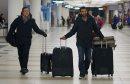 Toronto Blue Jays', Jose Bautista, right, pulls his luggage through at James Armstrong Richardson Airport, January 5, 2013. Winnipeg is one of the stops on the 3rd Annual Toronto Blue Jays Winter Tour. (TREVOR HAGAN/WINNIPEG FREE PRESS)