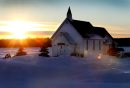 Lilyfield United Church is illuminated by the sun as it sets across a field near Sturgeon Rd. Tuesday afternoon. Standu