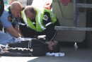 Pedestrian hit- A pedestrian was hit near 130 PM Tuesday afternoon at Euclid Ave and Main St in southbound lane- Emergency medial crews look after him–Southbound traffic on Main St crawling- Apr 02, 2013   (JOE BRYKSA / WINNIPEG FREE PRESS)