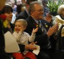 Canad Inns Pres. CEO Leo Ledohowski , with grandson Spencer age 2 clapping enthusiastically ,with  his daughter Lea Ledohowski Project Mgr. at opening  Canad Inns Destination Centre Health Science Centre officially opens , it is connected to HSC and offers 191 rooms banquet room and conference centre , restaurants  ans a Starbucks  KEN GIGLIOTTI / April . 29 2013 / WINNIPEG FREE PRESS