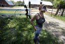June 8, 2013 - 130608  - Arrayl Mason, owner of Aesgard Ranch, is photographed at her horse ranch Saturday June 8, 2013. A group gathered in front of Aesgard Ranch on highway 8 Saturday, June 8, 2013 in response to alleged animal abuse. John Woods / Winnipeg Free Press