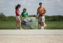 June 8, 2013 - 130608  - A young family gathered with a group in front of Aesgard Ranch on highway 8 Saturday, June 8, 2013 in response to alleged animal abuse. John Woods / Winnipeg Free Press