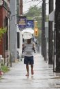 June 23, 2013 - 130623  - On Selkirk Avenue a Winnipegger gets creative with his head covering during a rain storm this afternoon Sunday, June 23, 2013. John Woods / Winnipeg Free Press