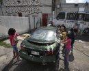Children wash ...