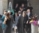 Mourners leave ...