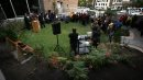 """Guests circulate around a newly opened """"green space"""" at the opening ceremony for Bab's Asper Lilac Garden at the U of W Thursday. See release/story. October 3, 2013 - (Phil Hossack / Winnipeg Free Press)"""
