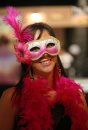 Jasmine Maiorino tries wearing a mask and boa at Mardi Gras at the Winnipeg Convention Centre, Saturday, February 15, 2014. (TREVOR HAGAN/WINNIPEG FREE PRESS)