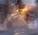 A grader and front end loaders clear out the ice on Selkirk Ave. between Main St. and Charles St. after a large water main break that occurred aprox. 1A.M. Thursday morning. Wayne Glowacki / Winnipeg Free Press Feb. 27   2014