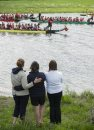 140607 Winnipeg - DAVID LIPNOWSKI / WINNIPEG FREE PRESS (June 07, 2014)  Kim Shepherd (centre) is comforted by her sister Cheryl Meyer (right), and friend Tammi Peters (left) as Dragon Boat competitors participate in a flower ceremony at the 2014 River City Dragon Boat Festival at the Manitoba Water Ski Park on Lake Shirley Saturday afternoon. One of the Dragon Boats, Kyle's Crusaders, was entered in honour of Kim Shpherd's son Kyle, who recentely died of cancer. Paddlers threw flowers into the water to honour cancer survivors and remember loved ones lost.