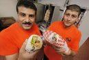 July 28, 2014 - 140728  -  Samy Ebrahim (L) and Tahsin Adel owners of Best Pizza and Donair with a Lamb Kabob Sandwich (L) and Donair in a Pita in Winnipeg Monday, July 28, 2014.  John Woods / Winnipeg Free Press