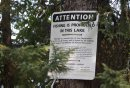Sign by lake ...
