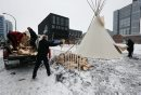 "Stdup Scared Fire - Members of the Downtown BIz unload wood for the Sacred Fire to be lite inside the Tee Pee .Stdup DOWNTOWN IGNITES A SACRED FIRE IN HONOUR OF ASSEMBLY OF FIRST NATIONS CONFERENCE: DEC. 8 Downtown Winnipeg – Kevin Settee, an Ojibway Cree youth from Matheson Island and University of Winnipeg student, will be the Fire Keeper and Pipe Carrier of the Sacred Fire.A sacred fire will be lit on December 8 at 9:00 a.m. at the beginning of what will be a full-day of ceremonies in honour of the Assembly of First Nations (AFN) Special Chiefs Assembly.The  Sacred Fire is in honour of AFN Special Chiefs Assembly .The Pipe ceremony and lighting of Sacred Fire on Dec. 8 at 9:00 a.m. former Carlton Inn (St. Mary & Carlton)""Prayers and intentions are offered through the fire with an offering of tobacco into the fire,"" says Lisa Meeches, Executive Director of Manito Ahbee. ""The sacred fire welcomes all to come and join and be a part of the ceremonies.""Kevin, along with other student volunteers and members of the Downtown Winnipeg BIZ will keep the fire burning 24 hours a day, until the AFN Special Chiefs Assembly concludes on Dec. 11.3,000 delegates of the Assembly of First Nations Special Chiefs Assembly will be arriving in  downtown Winnipeg."". Dec. 8 2014 / KEN GIGLIOTTI / WINNIPEG FREE PRESS"