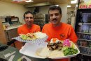 RESTAURANT REST REVIEW - Best Pizza and Donair. Edwar Shehata and Samy Ebrahim pose for a photo with chicken shwarma and donair platter from the restaurant. BORIS MINKEVICH/WINNIPEG FREE PRESS. JANUARY 19, 2015
