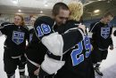 March 16, 2015 - 150316  -  Oak Park Raiders celebrate a winn over the St Paul's Crusaders in the AAAA High School Hockey Championship game at St James Civic Centre  Monday, March 16, 2015. John Woods / Winnipeg Free Press  March 16, 2015 - 150316  -  Oak Park Raiders defeated the St Paul's Crusaders in the AAAA High School Hockey Championship game at St James Civic Centre  Monday, March 16, 2015. John Woods / Winnipeg Free Press