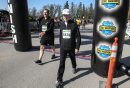 Lawrence Traa (left) who has brain cancer and Mark McDonald, the executive director of the Canadian Cancer Society's Manitoba Division cross the finish line together during the Winnipeg Police Half-Marathon at Assiniboine Park Sunday morning. 150503 - Sunday, May 03, 2015 -  (MIKE DEAL / WINNIPEG FREE PRESS)