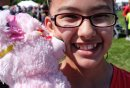 Emily Manabat, 12, with her teddy bear at the Teddy Bears' Picnic at Assiniboine Park. The event brings around 30,000 people to the park, mostly kids with their stuffed toys that are damaged and need fixing. The money raised goes towards the Children's Hospital Foundation of Manitoba.  150531 May 31, 2015 Mike Deal / Winnipeg Free Press