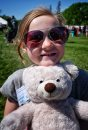 Hayley Doig, 7, with her teddy bear at the Teddy Bears' Picnic at Assiniboine Park. The event brings around 30,000 people to the park, mostly kids with their stuffed toys that are damaged and need fixing. The money raised goes towards the Children's Hospital Foundation of Manitoba.  150531 May 31, 2015 Mike Deal / Winnipeg Free Press