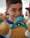 Frankie Rumore, 7, with his teddy bear at the Teddy Bears' Picnic at Assiniboine Park. The event brings around 30,000 people to the park, mostly kids with their stuffed toys that are damaged and need fixing. The money raised goes towards the Children's Hospital Foundation of Manitoba.  150531 May 31, 2015 Mike Deal / Winnipeg Free Press