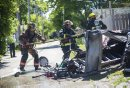 Firefighters haul a hose out to the back at a garage fire at 703 Burrows Avenue in Winnipeg on Thursday, June 18, 2015.  Nobody appeared to be injured, but children in a day home were evacuated. Mikaela MacKenzie / Winnipeg Free Press