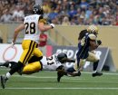 Winnipeg Blue Bombers' Paris Cotton (34) evades a tackle and scores an early touchdown against the Hamilton Tiger-Cats'  during first half CFL action, Thursday, July 2, 2015. (TREVOR HAGAN/WINNIPEG FREE PRESS)