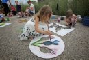 Zinnia O'Leary, 7, paints flowers in the parking lot of the Living Prairie Museum during 9th Annual Monarch Butterfly Festival. 150719 July 19, 2015 MIKE DEAL / WINNIPEG FREE PRESS