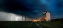 PHIL HOSSACK / WINNIPEG FREE PRESS 070619 LIGHTNING ILLUMINATES AN ABANDONED GRAIN EL