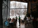 Patrons inside the Park Café in the Qualico Family Centre in Assiniboine Park get a beautiful view of the heavy snow falling in the park through many windows in the facility - Standup Photo–Dec 16, 2015   (JOE BRYKSA / WINNIPEG FREE PRESS)
