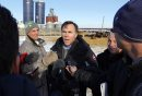 Minister of Finance Bill Morneau in Dugald, MB visiting a cattle farm. It's part of a Pre-Budget Consultations from coast to coast. He visited Calvin Vaag's cattle farm in frigid -20c temps. Here he is swarmed by journalists at the farm. BORIS MINKEVICH / WINNIPEG FREE PRESS January 14, 2016