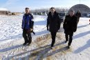 Minister of Finance Bill Morneau in Dugald, MB visiting a cattle farm. It's part of a Pre-Budget Consultations from coast to coast. He visited Calvin Vaag's cattle farm in frigid -20c temps. Left to right - farmer Calvin Vaag, minister Bill Morneau, and Dan Vandal. BORIS MINKEVICH / WINNIPEG FREE PRESS January 14, 2016