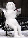 A snowman sits ...