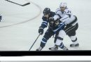 MIKE DEAL / WINNIPEG FREE PRESS Winnipeg Jets' Nic Petan (19) and Los Angeles Kings' Nick Shore (21) during an afternoon NHL game at MTS Centre Sunday. 161113 - Sunday November 13, 2016