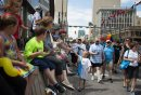 JEN DOERKSEN/WINNIPEG FREE PRESS A young boy hands out pride stickers to supporters on Portage Avenue at Main Street for the 30th annual Pride Parade. Sunday, June 4, 2017.