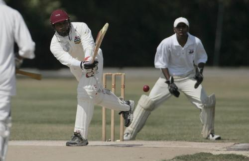 John Woods / Winnipeg Free Press / August 5 2006 - 060805 - Alberta batsman Rakesh Patel                                                                                                          hits against Manitoba wicket keeper Sampath Wijewerdana in the Western Canadian Cricket Championships at Assiniboine Park Saturday, August 5/06.