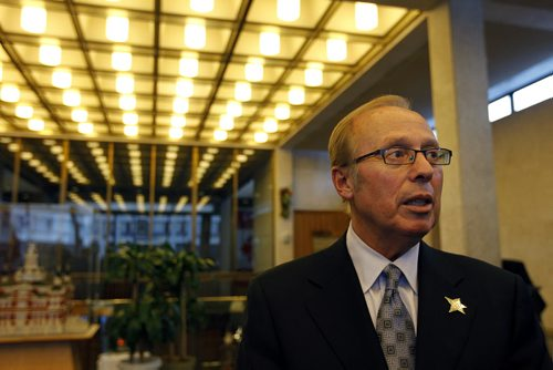 TREVOR HAGAN / WINNIPEG FREE PRESS - Mayor Sam Katz addresses the media following a meeting where city council approved its end of a plan to complete a $190-million football stadium at the University of Manitoba. 10-12-15