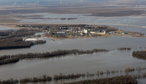 JOE.BRYKSA@FREEPRESS.MB.CA  St Jean Baptiste, Manitoba- ( See Lindor's story)-   The town of St Jean Baptiste is  surrounded by the flooded Red River  Wednesday morning- Manitoba. St Jean Baptiste  is located along Highway 75, 40 km north of Emerson at the United States border- The town of St Jean Baptiste is protected   by a permanent ring dike keeping it safe from the flood waters -JOE BRYKSA/WINNIPEG FREE PRESS- Apr 20, 2011