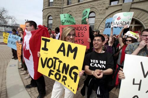 "MIKE.DEAL@FREEPRESS.MB.CA 110427 - Wednesday, April 27, 2011 - Brittany Thiessen (with yellow sign), who helped orgainize the event, along with a few hundred students showed up for a ""vote mob"" at the University of Winnipeg around the lunch hour. The planed event was designed to encourage young people to vote. See Nick Martin story. MIKE DEAL / WINNIPEG FREE PRESS"