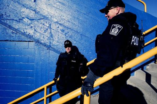 CHRISTOPHER PIKE/WINNIPEG FREE PRESS Winnipeg police officers stand in Canad Inns Stadium prior to the BC Lions vs. Montreal Alouettes in the 94th Grey Cup at Canad Inns Stadium in Winnipeg, Man. on Sunday Nov. 19, 2006.