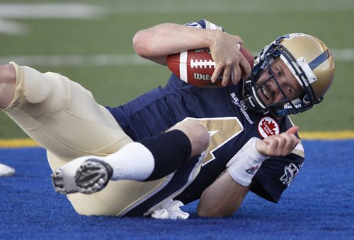 Buck Pierce falls into the endzone after scrambling long touchdown run late in the first half of CFL action at Canad Inns Stadium. The Bombers trail the Eskimos 13-12 after the first half. (TREVOR HAGAN/WINNIPEG FREE PRESS)