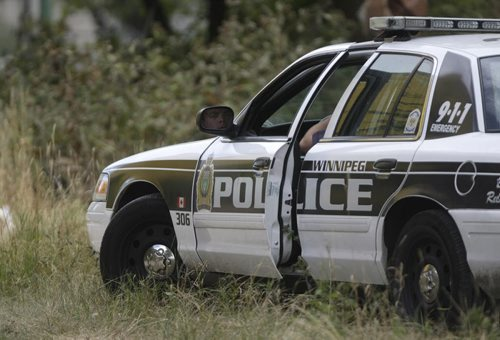Winnipeg Police and an Identification unit were on scene behind a vacant building on the 700 block of Main Street, August 28th, 2011. April Helen Hornbrook, 24, of Winnipeg was found dead, Saturday morning. (TREVOR HAGAN/WINNIPEG FREE PRESS) - See Melissa Martin story