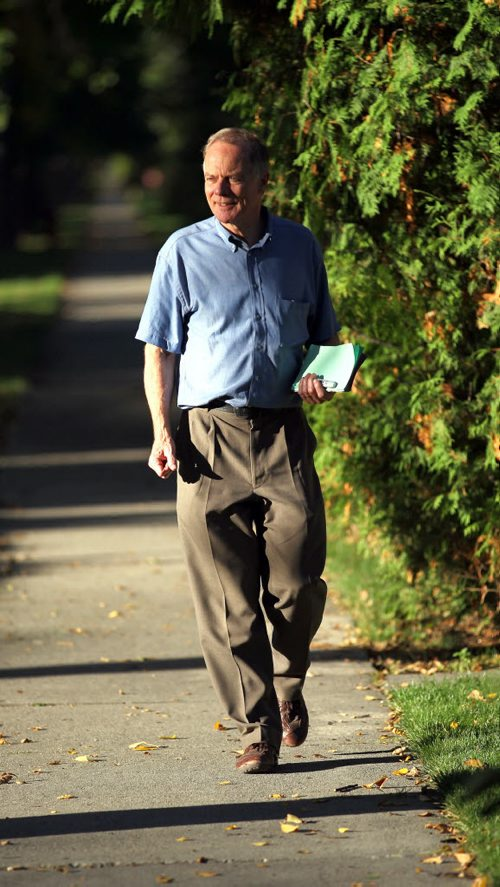 Dr Jon Gerrard walks the beat in River Heights on the campaign trail Tuesday. See story. Sept 27, 2011 (Phil Hossack - Winnipeg Free Press)