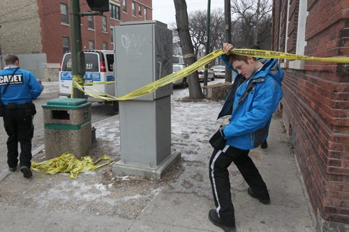 Police  are releasing no new information Sunday on why they are holding a crime scene at 270 Morley Ave in South Osborne–Neighbors report seeing a body being removed Saturday from the block-Several police and cadets are on scene gauring the block- See Alex Paul story– Dec 04, 2011   (JOE BRYKSA / WINNIPEG FREE PRESS)
