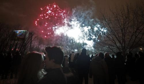 Daria Sywak (left) and Matt Cassie (right) kiss during the New Years Eve fireworks display at The Forks celebrating the new year, 2012. 111231 - Saturday, December 31, 2011 -  (MIKE DEAL / WINNIPEG FREE PRESS)