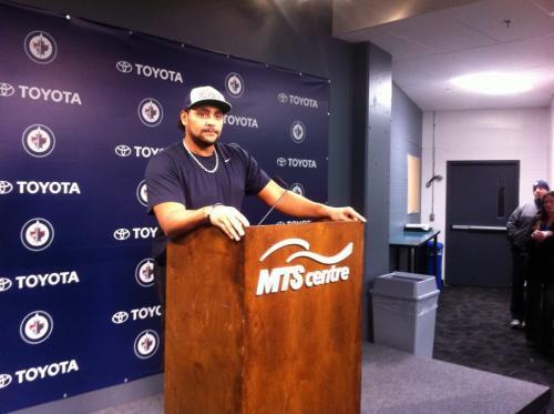 Tyler Walsh photo of  Dustin Byfuglien at podium Winnipeg Free Press