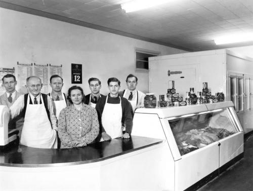 Riediger's founder Henry Riediger and his children stand behind the meat counter of their brand-new grocery at 188 Isabel Street in 1946. From left to right: Unknown Employee, Henry Riediger Sr., Henry Riediger Jr., Susie Riediger, Nick Riediger Sr., Vern Riediger, John Riediger.  - for winnipeg free press