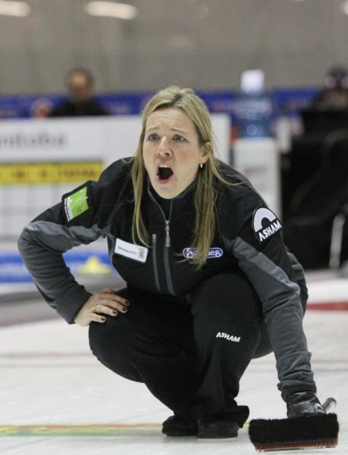 Skip Cathy Overton-Clapham shouts after throwing a rock during the Friday afternoon draw against Team Carey in the Scotties Tournament of Hearts at the Portage la Prairie PCU Centre. 120127 Mike Deal / Winnipeg Free Press