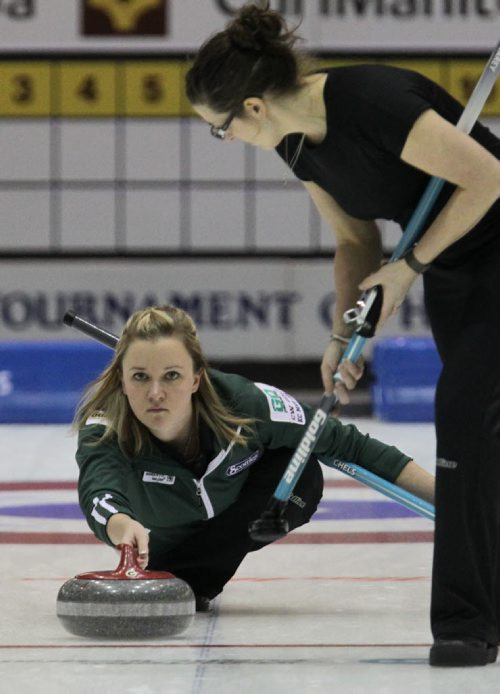 Skip Chelsea Carey throws a rock during the Friday afternoon draw against Team Overton-Clapham in the Scotties Tournament of Hearts at the Portage la Prairie PCU Centre. 120127 Mike Deal / Winnipeg Free Press